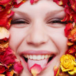 Stock Photo: Female face with roses