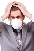 Man in white respirator — Stockfoto