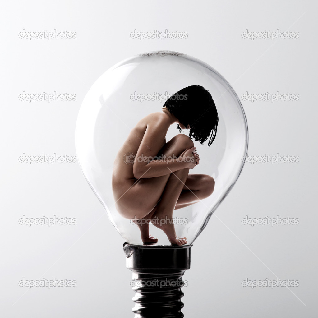 Beauty naked woman sitting in empty bulb — Stock Photo #2575236