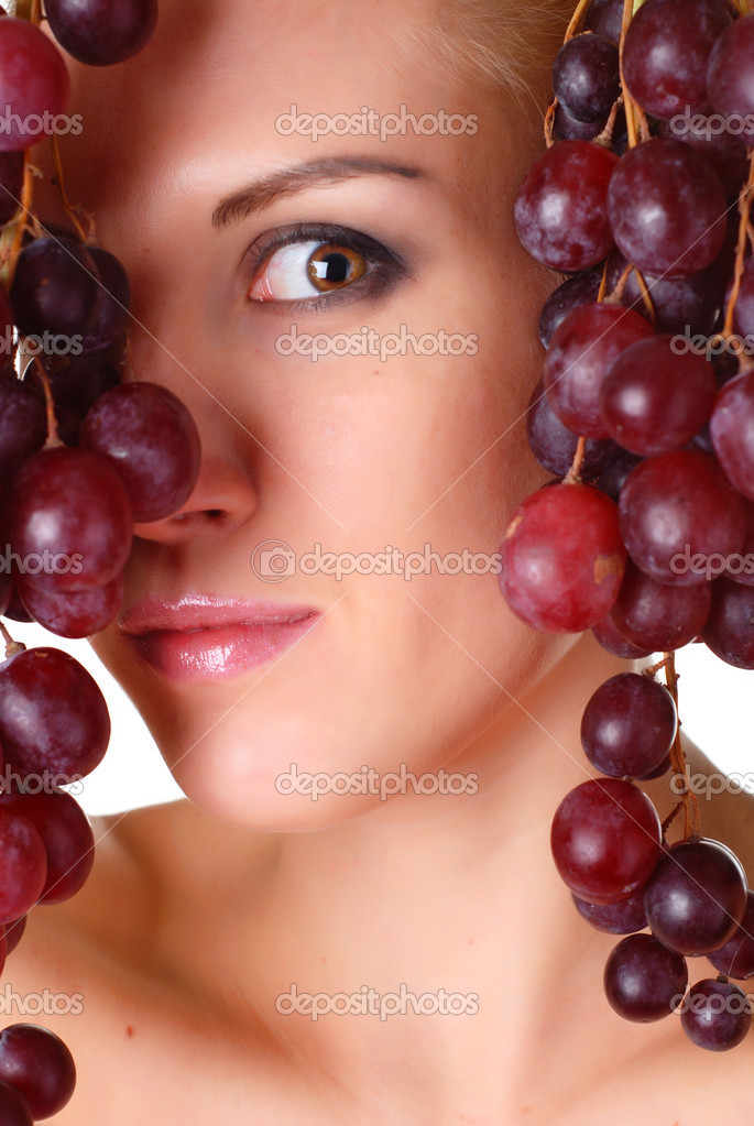 Portrait of a beautiful woman with bunch of grape  Stock Photo #2575485