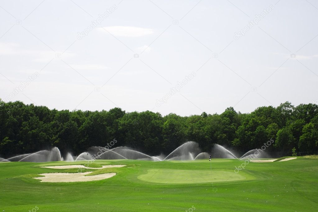 Pictire of golf landscape with green grass and articial irrigation — Stock Photo #2575614