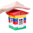 Hand and toy colour house — Stock Photo
