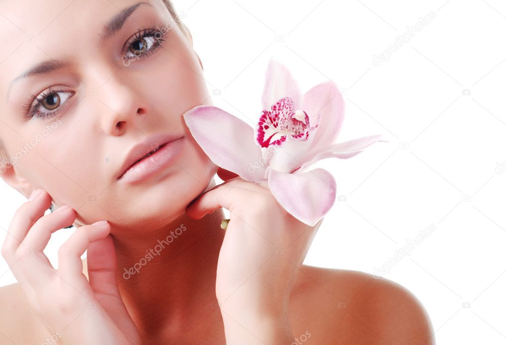 Face of beautiful young woman with delicate orchid — Stock Photo #2587868