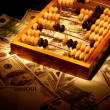 Old abacus on dollars and euro backgroun — Stock Photo