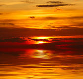 Sunset over water — Stock Photo