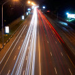 Car lights on highway in the night — Stock Photo