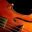 Part of vintage violin on black backgrou - Stockfoto