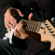 Musician playing electric guitar — Stock Photo