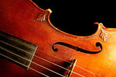 Part of vintage violin on black backgrou — Stock Photo