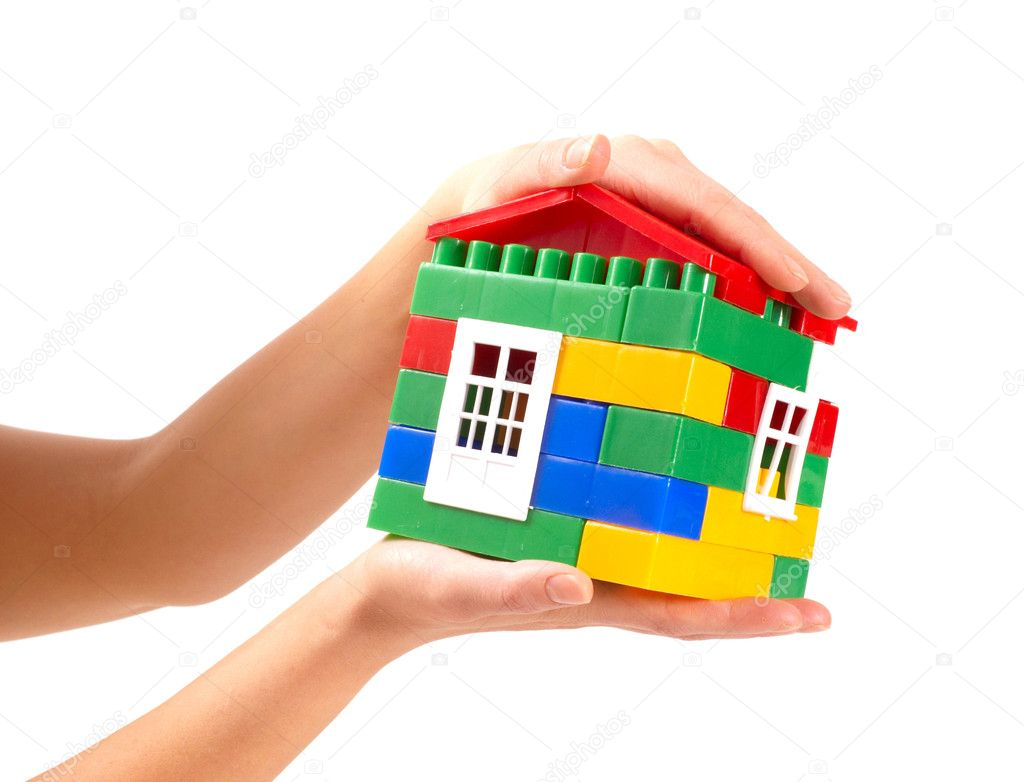 Small house in woman hands — Stock Photo #1863098