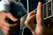 Musician playing guitar — Stock Photo