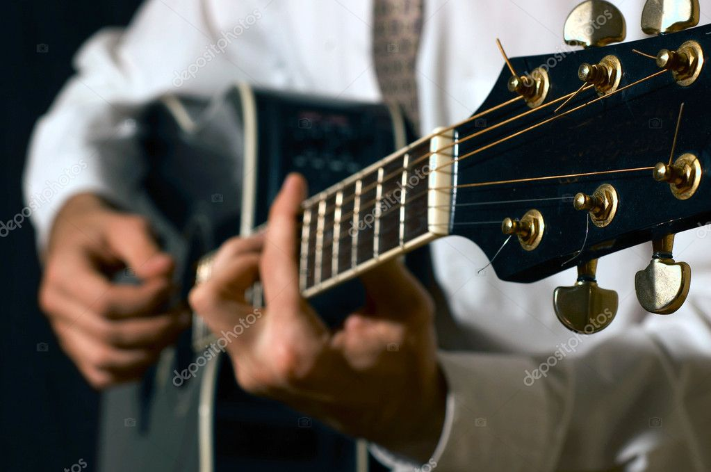Musician playing guitar — Stock Photo #1996948
