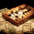 Stock Photo: Old abacus on dollars and euro backgroun