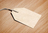 Blank tag on wooden background — Stock Photo