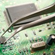 Foto Stock: Assembling circuit board