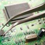 Assembling a circuit board — Stock Photo