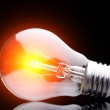 Photo of light bulb on black — Stock Photo