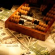 Old abacus on dollars and euro backgroun — Foto de Stock