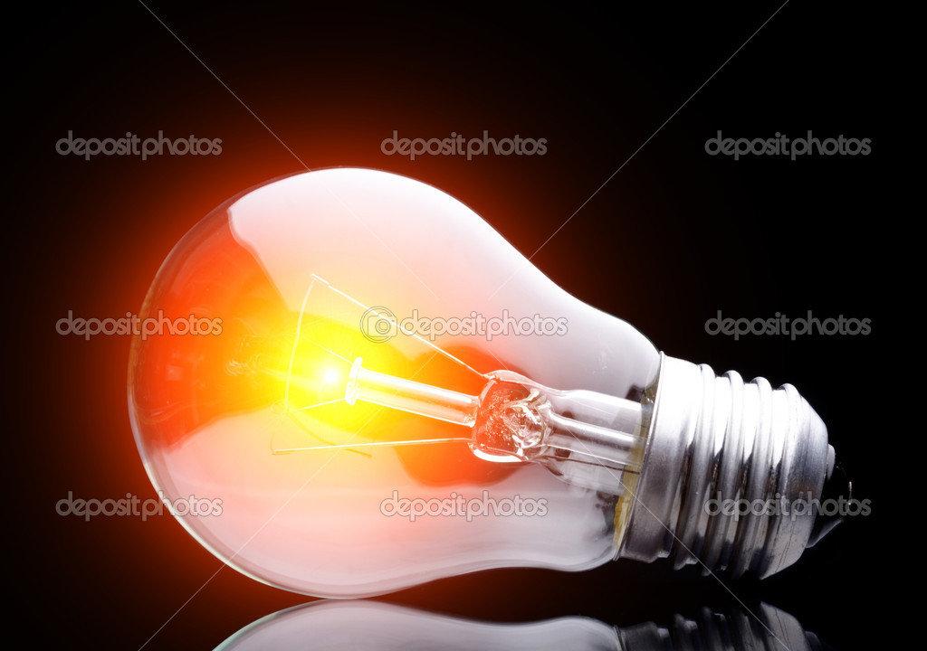 Photo of light bulb on black — Stock Photo #2384751