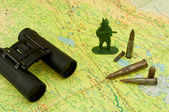 Binoculars on the map — Stock Photo