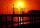 Plank pier extending over calm water — Stock Photo
