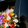 Bride looks out of the car — Stock Photo #2026635