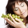 Royalty-Free Stock Photo: Woman with green grapes