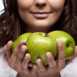 Royalty-Free Stock Photo: Girl with fresh three green apples
