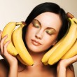 Brunette with bananas — Stock Photo