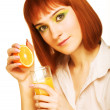 Royalty-Free Stock Photo: Woman drinking orange juice close up
