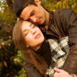 Foto Stock: Lovely couple in autumn park