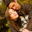 Lovely couple in autumn park — Stock fotografie