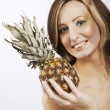 Young lovely woman  with pineapple - Stock Photo