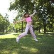 Stock Photo: Little girl jumping in park