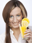 Woman with glass of juice — Stock Photo