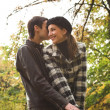 Loving couple in an autumnal park — Stock Photo