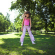 Little girl jumping in  park — Stock Photo