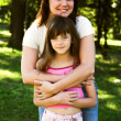 Mother and daughter in park — Stock Photo #1856217