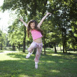 Royalty-Free Stock Photo: Little girl jumping in  park