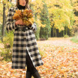 Young woman in autumnal park - Stock Photo