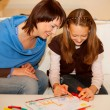 Stock Photo: Mother and her daughter drawing.