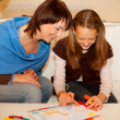 Mother and her daughter drawing. — Stock Photo #1857920
