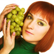 Woman with bunch of grapes — Stock Photo