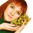 Woman with bunch of grapes — Stock Photo #1857970