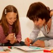 Mother and her daughter drawing. — Stock Photo #1858072