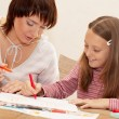 Mother and her daughter drawing. — Stock Photo #1858075