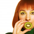 Woman with kiwi on white - Stock Photo
