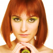 Woman with kiwi on white — Stock Photo