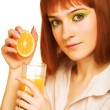 Woman drinking orange juice close up — Stock Photo #1858175
