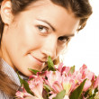 Woman with pink flowers — Stock Photo